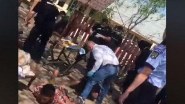 Bărbat culcat la pământ, bătut crunt de șeful Poliției din Bolintin Vale VIDEO